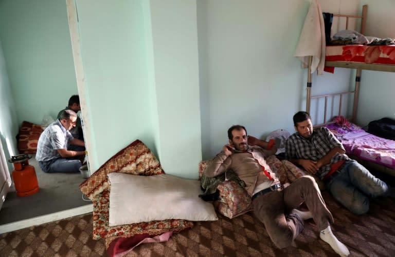 Squeezed by sanctions, Iranians seek day jobs in Kurdish Iraq