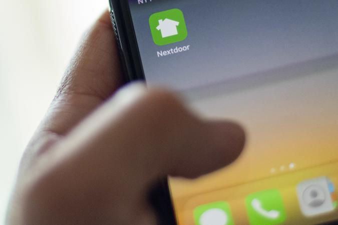 Nextdoor, the hyper local social network, is seen on a smartphone screen in Washington, DC, on March 27, 2020. - There are offers to pick up groceries or medicine for neighbors, to share supplies, or walk people's dogs. And exchange information on where to find scarce items like toilet paper.  For people forced to stay home to ride out the coronavirus pandemic, Nextdoor, the hyperlocal social network, has found itself playing an increasingly important role. (Photo by Eric BARADAT / AFP) (Photo by ERIC BARADAT/AFP via Getty Images)