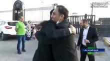 Iranian scientist freed from US custody returns to Iran