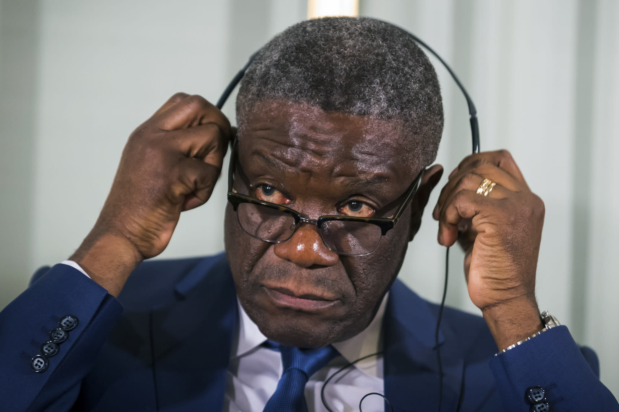 FILE - In this Sunday Dec. 9, 2018 file photo, Dr. Denis Mukwege from Congo prepares to listen to questions, with Nadia Murad from Iraq, at a media conference for the 2018 Nobel Laureates at the Nobel Institute in Oslo, Norway. Death threats against the Nobel Peace Prize-winning Congolese doctor have alarmed his supporters who are urging in Sept. 2020 the United Nations to reinstate protection by its peacekeepers, but it likely won't return. (Heiko Junge/NTB Scanpix via AP, File)