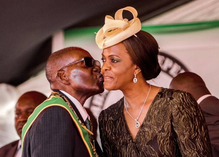 Mugabe, seen here with his wife and first lady Grace Mugabe, went on to rule for nearly four decades (AFP Photo/Jekesai NJIKIZANA)
