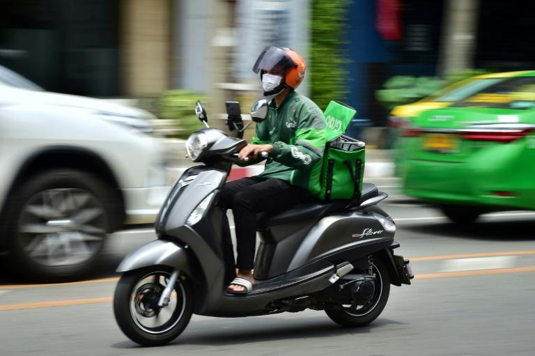 Many restaurants in Thailand have been forced to rely on their delivery service (AFP Photo/Lillian SUWANRUMPHA)