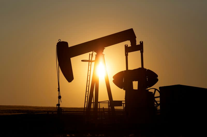 FILE PHOTO: An oil pump jack pumps oil in a field near Calgary