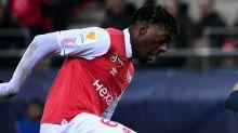 Monaco sign Reims defender Disasi