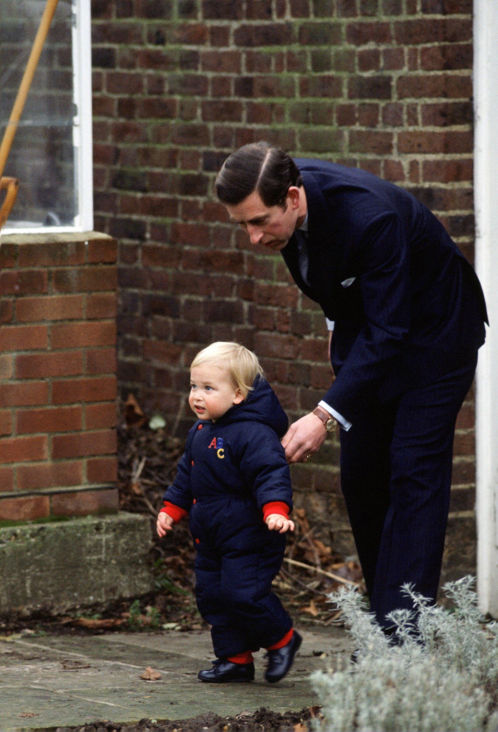 UNITED KINGDOM - DECEMBER 14:  Prince Charles, Prince of Wales with his son, Prince William, in the garden at Kensington Palace  (Photo by Tim Graham/Getty Images)
