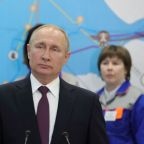 Putin, in Crimea for annexation anniversary, launches power stations