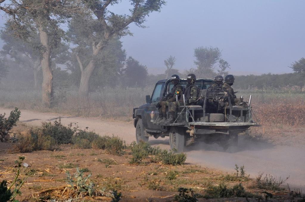 Members of the Cameroonian Rapid Intervention Force patrol on the outskirt of Mosogo in the far north region of the country where Boko Haram jihadists have been active since 2013, on March 21, 2019