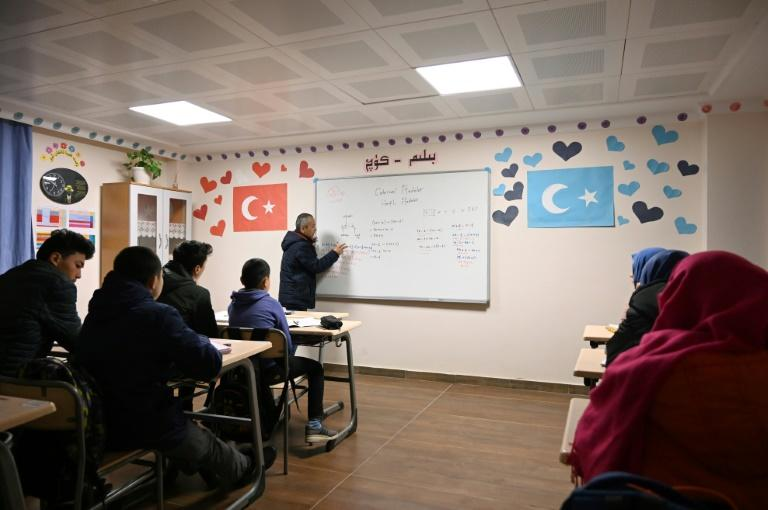 At a school on the outskirts of Istanbul, Uighur child refugees from China study their language and culture (AFP Photo/Ozan KOSE)