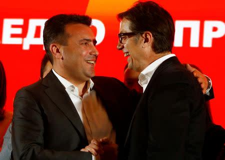 Macedonian Prime Minister Zoran Zaev and leader of the ruling SDSM greets presidential candidate Stevo Pendarovski during a news conference in Skopje, North Macedonia, April 21, 2019. REUTERS/Ognen Teofilovski