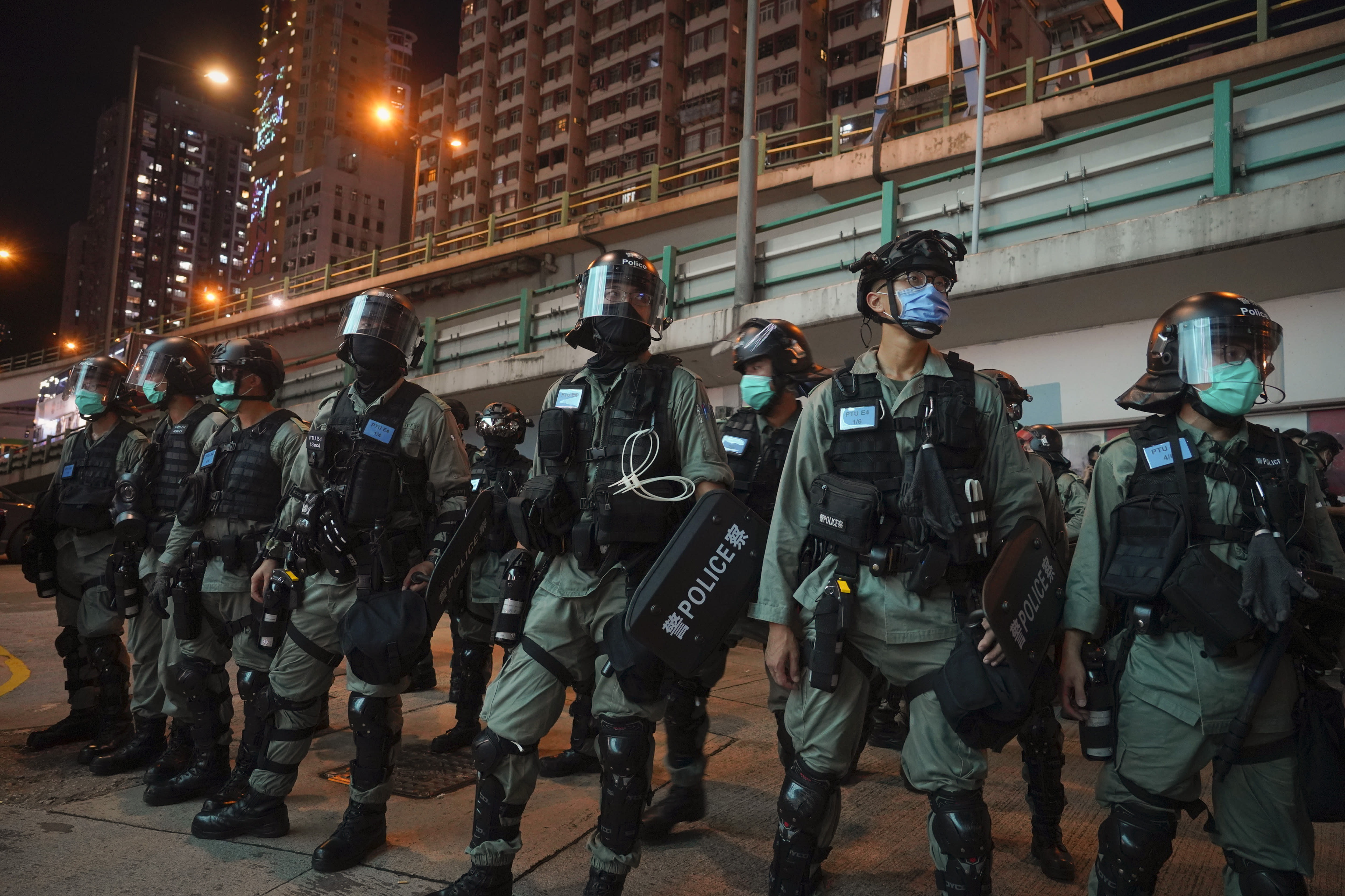 Riot police stand guard after pushing back protesters demonstrating against the new security law during the anniversary of the Hong Kong handover from Britain, Wednesday, July. 1, 2020, in Hong Kong. Hong Kong police have made their first arrests under a new national security law imposed by mainland China. The law, which took effect Tuesday night, makes activities deemed subversive or secessionist punishable by up to life in prison. (AP Photo/Vincent Yu)