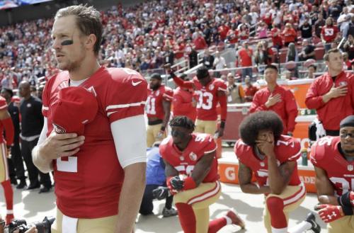 Blaine Gabbert (2) was signed before 2016 49ers teammate Colin Kaepernick (background, kneeling). (AP)
