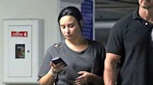 Demi Lovato Claps Back at Fan Who Accused Her 'Rotten' Team of Only Caring 'About Her Money'