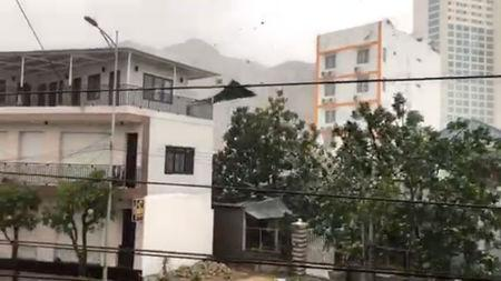 An object is blown by strong winds during a storm in Nha Trang, as Typhoon Damrey descends on southern Vietnam, in this still image taken from social media video, November 4, 2017. @SINITSYN_NIKITA/via REUTERS