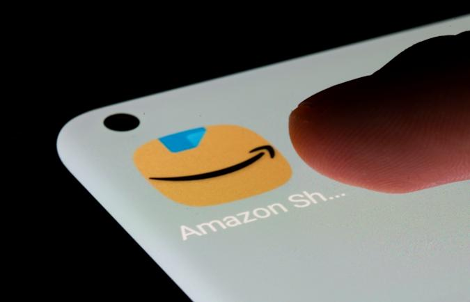 Amazon app is seen on a smartphone in this illustration taken, July 13, 2021. REUTERS/Dado Ruvic/Illustration