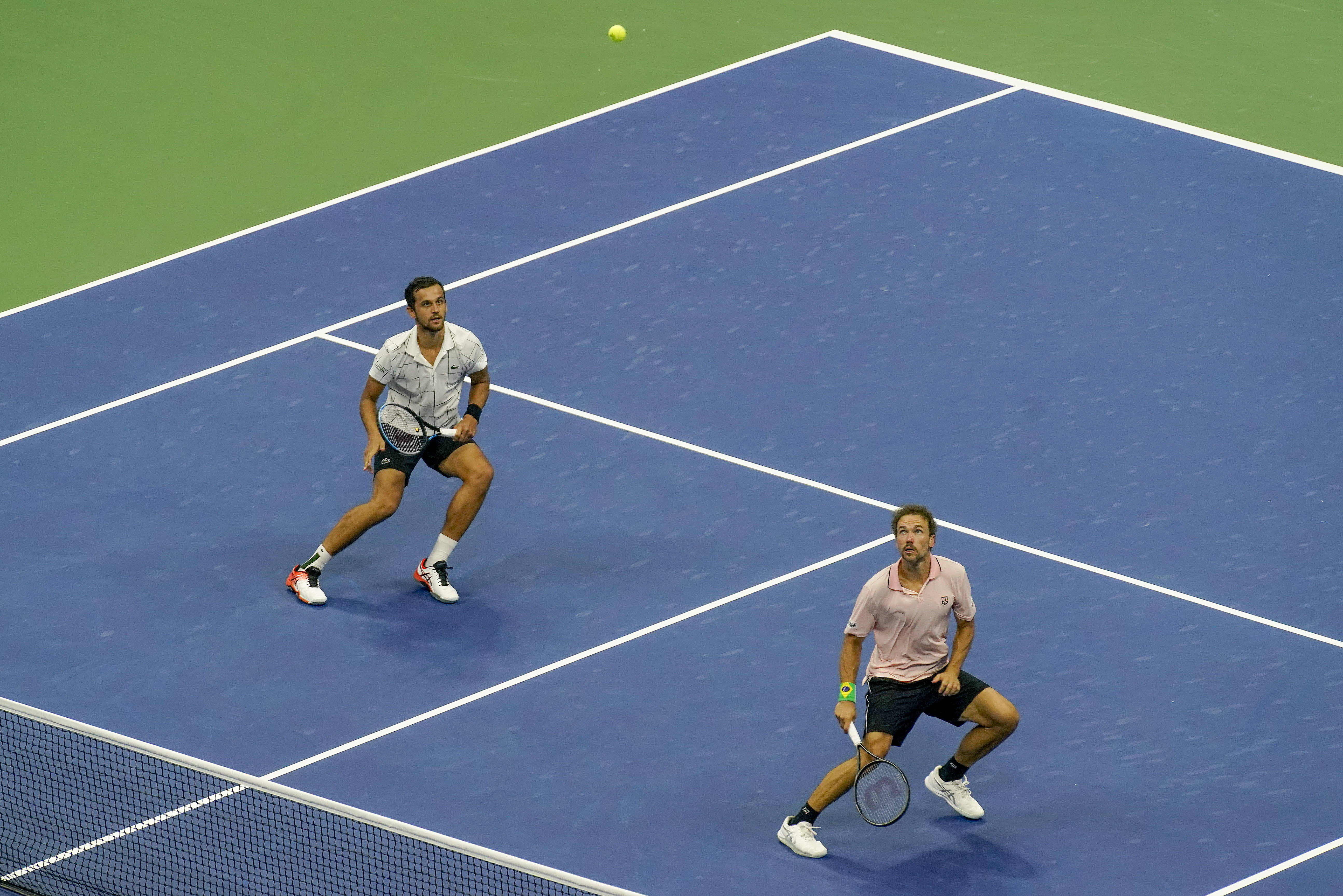 Mate Pavic, of Croatia, left, and Bruno Soares, of Brazil, chase down a shot from Wesley Koolhof, of the Netherlands, and Nikola Mektic, of Croatia, during the men's doubles final of the U.S. Open tennis championships, Thursday, Sept. 10, 2020, in New York. (AP Photo/Seth Wenig)