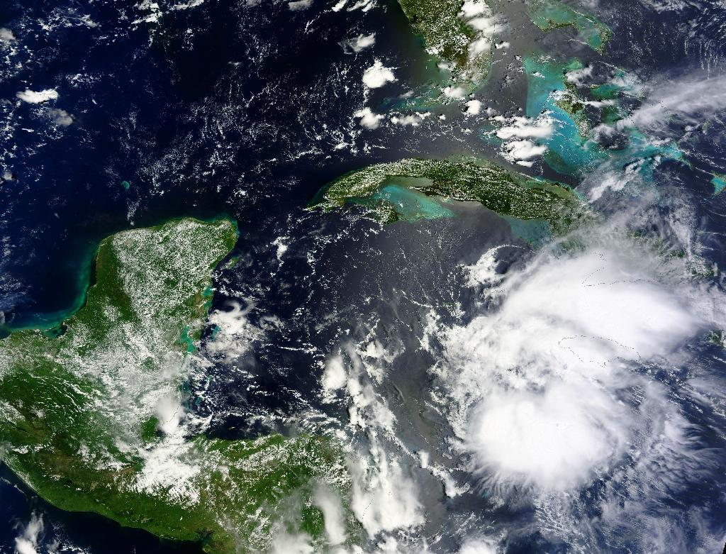 Tropical Storm Earl, pictured on August 2 in a NASA satellite image, left three dead in eastern Mexico, prompting officials to warn residents to remain prepared for floods or mudslides