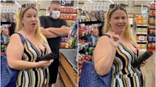 Video shows a woman threatening to shoot a bystander who confronted her for not wearing a face mask in a grocery store