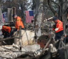 Crews push to contain California fires, search for bodies