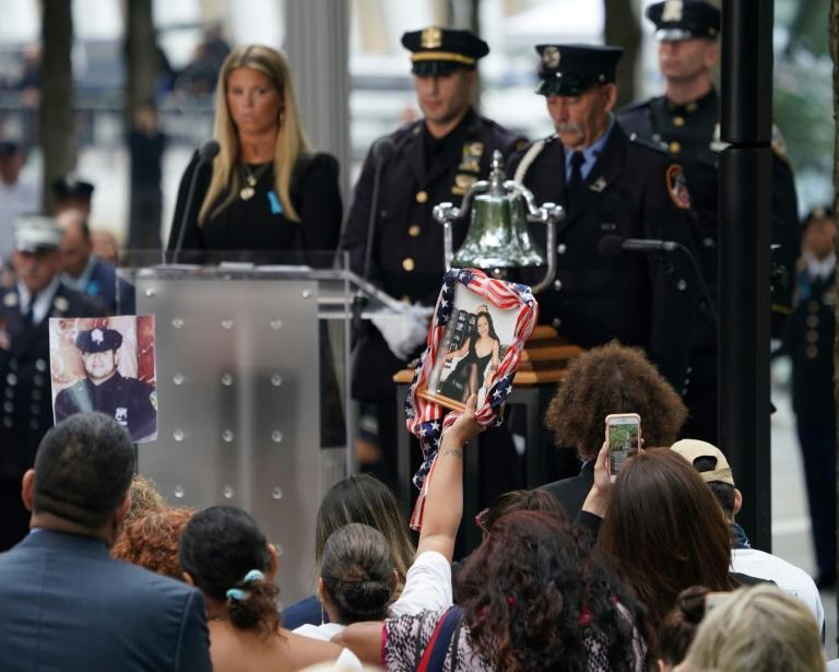 A relative holds a portrait of a victim during the September 11 Commemoration Ceremony at the 9/11 Memorial at the World Trade Center in New York (AFP Photo/Don Emmert)