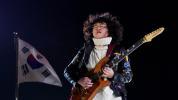 Shredding guitar kid rocks Closing Ceremony