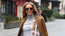 Amanda Holden wows in sparkling sheer dress while posing in a lift