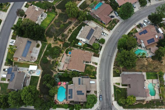 Solar panels are seen on rooftops amid the coronavirus disease (COVID-19) outbreak, in Santa Clarita, near Los Angeles, California, U.S., June 18, 2020. Picture taken June 18, 2020. REUTERS/Lucy Nicholson