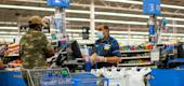 A worker and a shopper are seen wearing masks at a Walmart store, in North Brunswick, New Jersey, U.S. July 20, 2020. (REUTERS)
