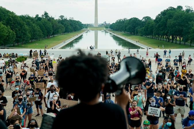 Protesters applaud during a rally against racial inequality in the aftermath of the death in Minneapolis police custody of George Floyd, at the Lincoln Memorial in Washington, U.S., June 10, 2020. REUTERS/Erin Scott