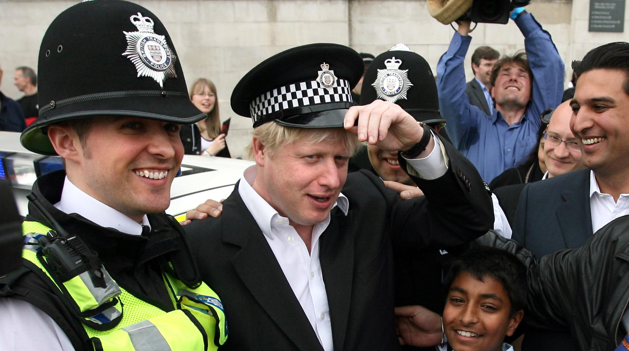 Newly elected London Mayor Boris Johnson wears a policeman's hat in Trafalgar Square, central London during the Sikh New Year Festival celebrations of Vaisakhi.