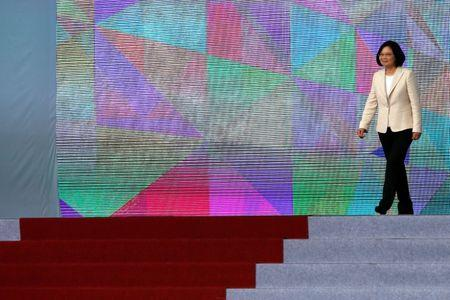 FILE PHOTO: Taiwan President Tsai Ing-wen walks on the podium before addressing during an inauguration ceremony in Taipei, Taiwan May 20, 2016. REUTERS/Tyrone Siu/File Photo