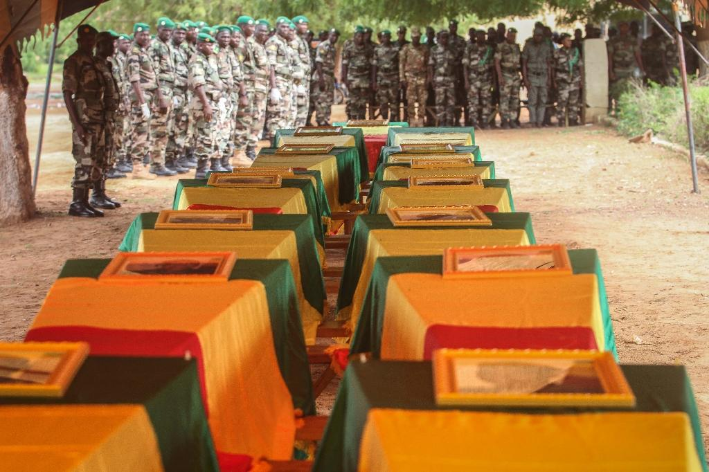 Coffins of Malian army officers killed in an attack are displayed on July 21, 2016 in Segou during a funeral ceremony