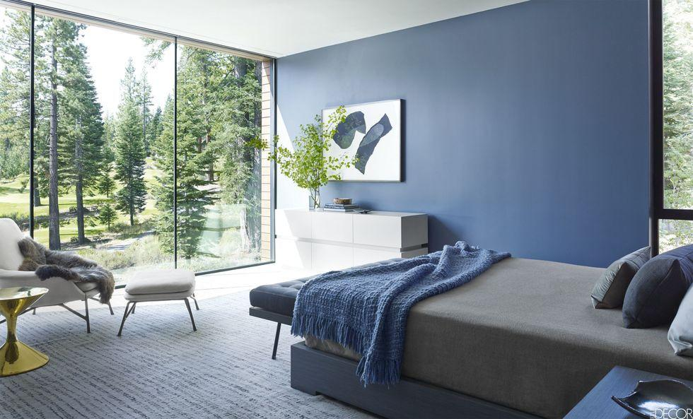 """<p>Blue has always been a go-to color for interior designers, and for good reason. It's versatile enough to work in just about any room, and the <a href=""""https://www.elledecor.com/design-decorate/color/g3202/blue-rooms/"""" rel=""""nofollow noopener"""" target=""""_blank"""" data-ylk=""""slk:range of shade options"""" class=""""link rapid-noclick-resp"""">range of shade options</a>—whether it's a misty gray or a <a href=""""https://www.elledecor.com/design-decorate/color/g26899072/best-teal-paint-colors/"""" rel=""""nofollow noopener"""" target=""""_blank"""" data-ylk=""""slk:lagoon teal"""" class=""""link rapid-noclick-resp"""">lagoon teal</a>—are endless. With a color that runs the gamut of light and warm to cool, deep, and sultry, you can satisfy nearly all design needs when turning to this section of the <a href=""""https://www.elledecor.com/design-decorate/color/a27793858/analogous-color-scheme/"""" rel=""""nofollow noopener"""" target=""""_blank"""" data-ylk=""""slk:color wheel"""" class=""""link rapid-noclick-resp"""">color wheel</a>. </p><p><br>Ready to dive into an ocean of blues? Below, some of our favorite interior designers share the blue paint shades they can't get enough of. Use their picks as inspiration to experiment with blue paint in one of your own designs. Read on for the best blue paint options to shop now.<br></p>"""