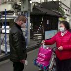 China cuts rates to lift virus-battered economy