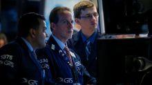 Dow snaps losing streak on energy lift