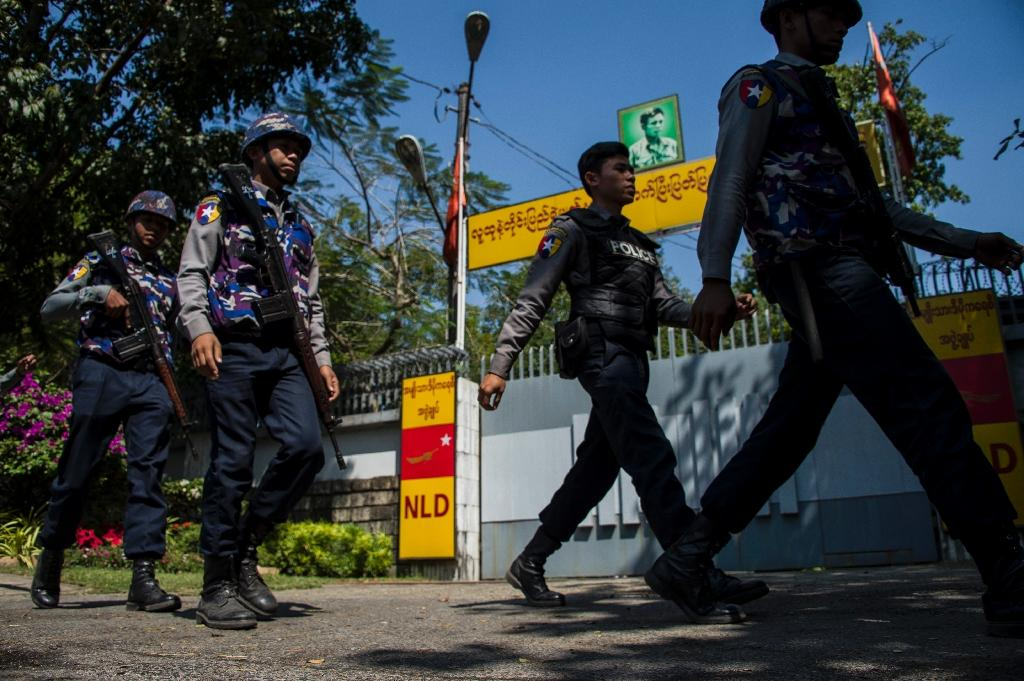 Police officers patrol in front of the residence of Myanmar's leader Aung San Suu Kyi in Yangon earlier this week after a petrol bomb was hurled into the compound (AFP Photo/YE AUNG THU)