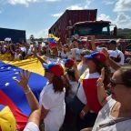 Prayers, holy water as Venezuelans push Curacao aid shipment