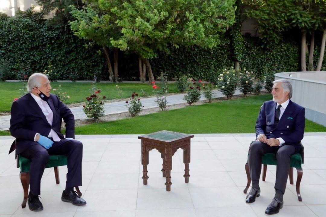 In this Wednesday, May 20, 2020 photo, Abdullah Abdullah, right, President Ashraf Ghani's fellow leader under a recently signed power-sharing agreement, holds a meeting with U.S. peace envoy Zalmay Khalilzad aimed at resuscitating a U.S.-Taliban peace deal signed in February, at the presidential palace, in Kabul, Afghanistan. (Sapidar Palace via AP)