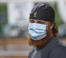 MLB reprimands Justin Turner for returning to field after positive coronavirus test