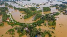 China evacuates thousands after floods threaten villages