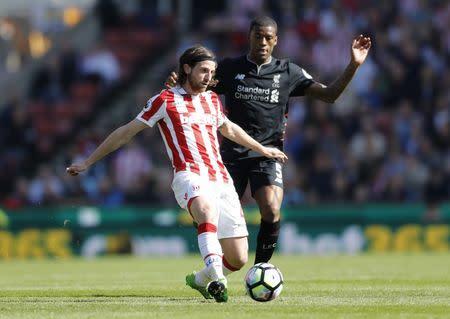 Stoke City's Joe Allen in action with Liverpool's Georginio Wijnaldum
