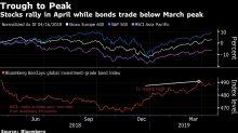 Acciones suben en medio de ganancias dispares; bonos caen