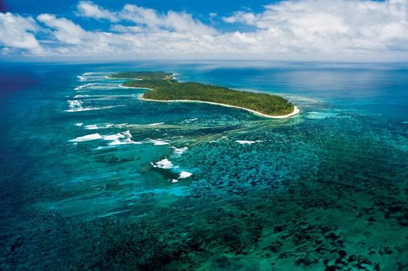 """<p> <a href=""""http://www.desroches-island.com/"""" target=""""_blank"""">Desroches Island</a> in the Indian Ocean is the perfect place for complete isolation and to de-stress on an exotic island. Its remoteness means there's no mobile phone signal and the only sounds you'll hear are the ones provided by Mother Nature! The paradise island is located 230km from Mahe in the Seychelles and can be reached by plane or yacht. Desroches is concealed beneath the shade of coconut palms and vegetation, with various beach retreats to sleep in. Stay in one of the Beach Villas, which have their own private gardens and swimming pools.</p>"""