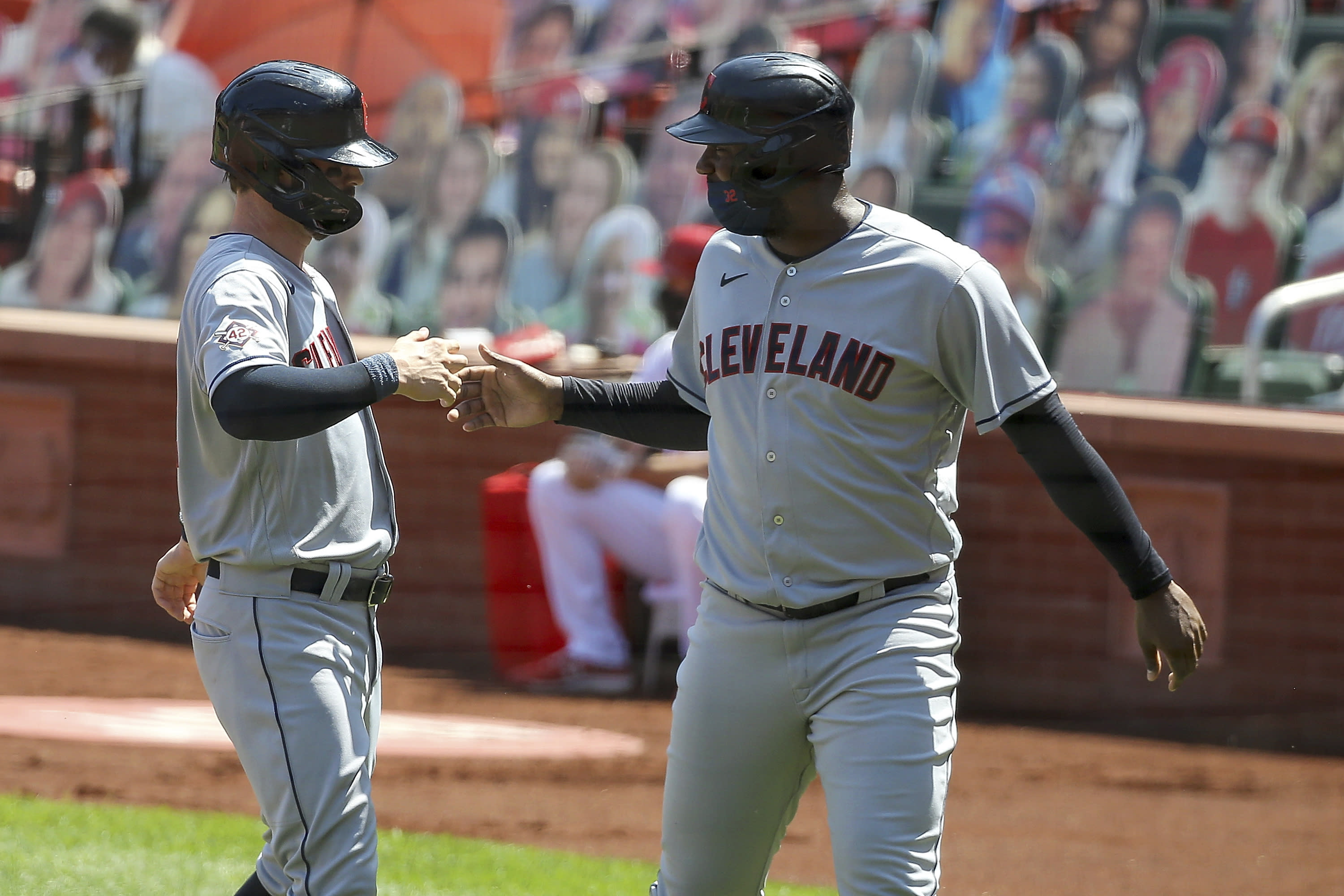 Cleveland Indians' Tyler Naquin, left, is congratulated by teammate Franmil Reyes after hitting a two-run home run during the second inning of a baseball game against the St. Louis Cardinals, Sunday, Aug. 30, 2020, in St. Louis. (AP Photo/Scott Kane)