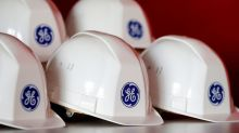 GE beats on EPS but trims cash flow target; shares fall