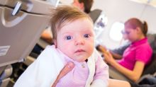 Parents Hand Out Goodie Bags To Plane Passengers In Case Their Twin Babies Kick-Off