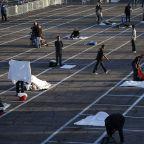 Las Vegas marking parking places for homeless encampment