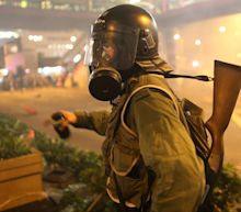 Hong Kong riot police fire tear gas during clashes with protesters amid further violent unrest