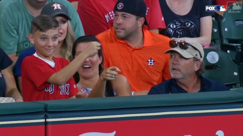 This Red Sox fan was just protecting himself after one fan interfered with a ball. (MLB.com Screenshot)