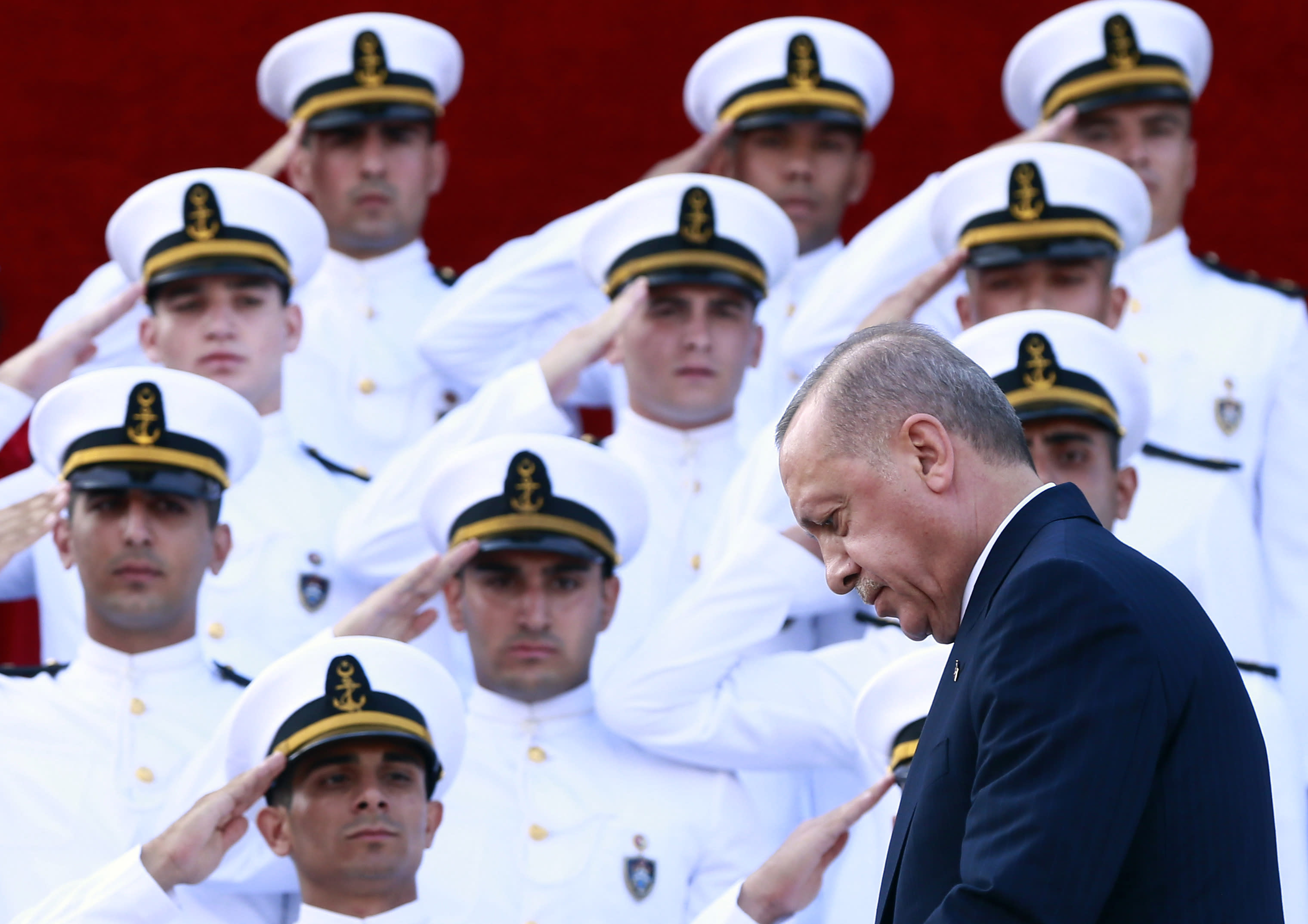 Turkey's President Recep Tayyip Erdogan, arrives to deliver a speech to graduates of a military academy in Istanbul, Saturday, Aug. 31, 2019. Erdogan said the U.S. had up to three weeks to satisfy Turkish demands and has threatened to launch a unilateral offensive into northeastern Syria if plans to establish a so-called safe zone along Turkey's border fail to meet his expectations. Earlier this month, Turkish and U.S. officials agreed to set up the zone east of the Euphrates River. (Presidential Press Service via AP, Pool)