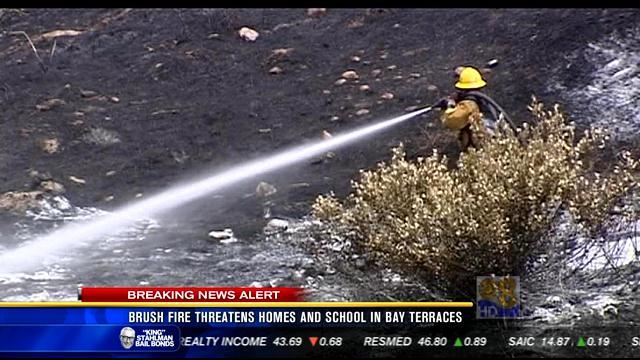 Brush fire threatens homes, school in Bay Terraces